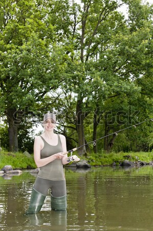 женщину рыбалки пруд Hat женщины Постоянный Сток-фото © phbcz