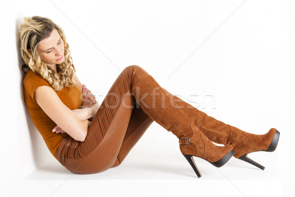 sitting woman wearing brown clothes and boots Stock photo © phbcz