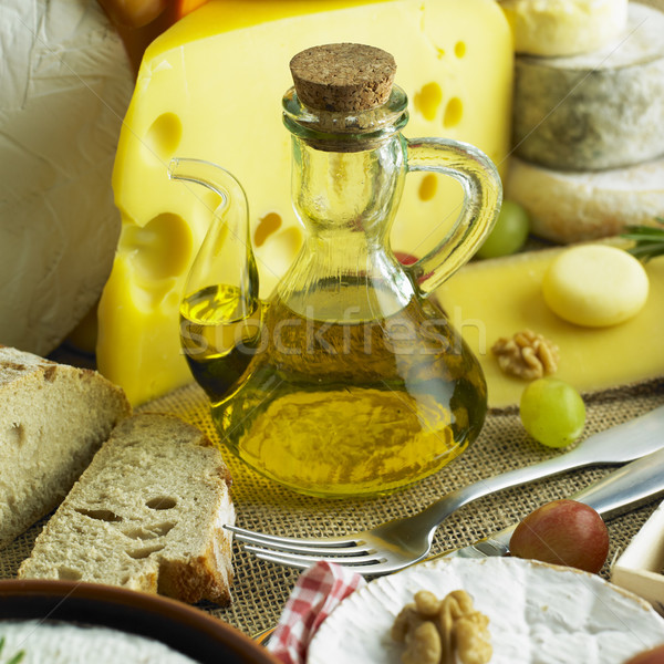 cheese still life with olive oil Stock photo © phbcz