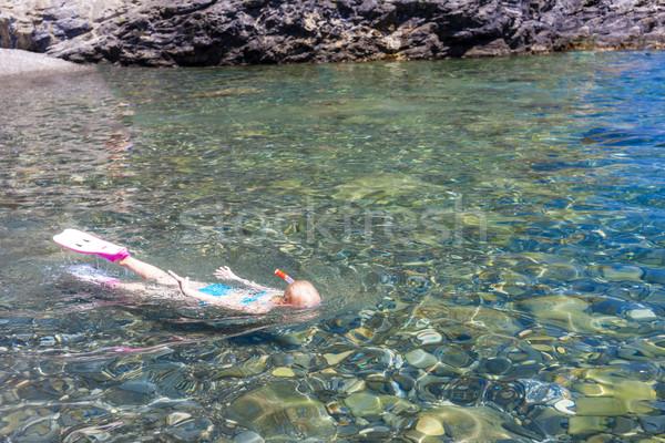 little girl snorkeling in Mediterranean Sea Stock photo © phbcz