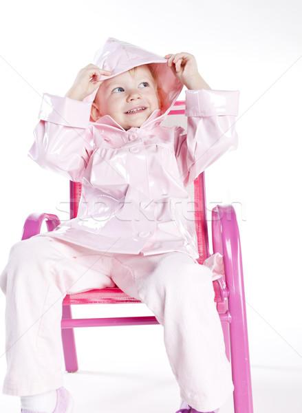 Petite fille imperméable séance président fille Photo stock © phbcz