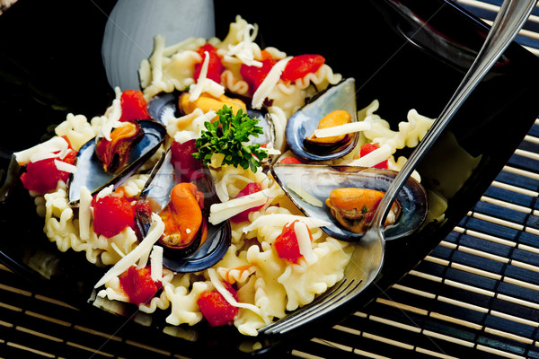 pasta with mussels and chopped tomatoes Stock photo © phbcz