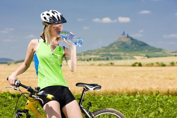biker with bottle of water, Hazmburk, Ceske stredohori, Czech Re Stock photo © phbcz