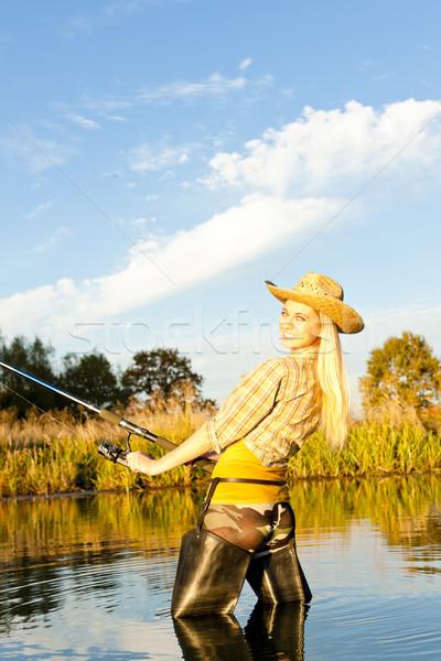 Mulher pescaria lagoa mulheres em pé botas Foto stock © phbcz