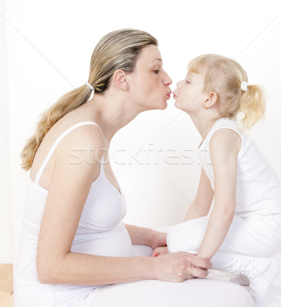 portrait of little girl with her pregnant mother Stock photo © phbcz
