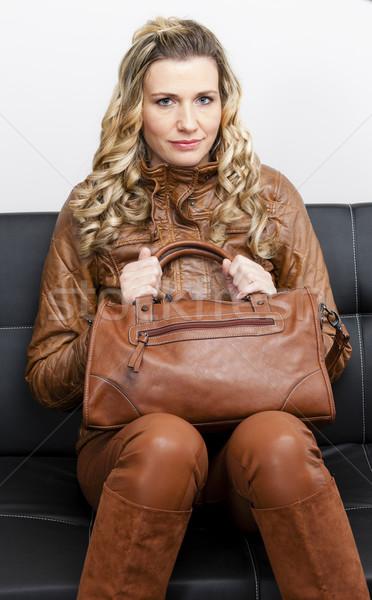 женщину коричневый одежды сапогах сумочка Сток-фото © phbcz