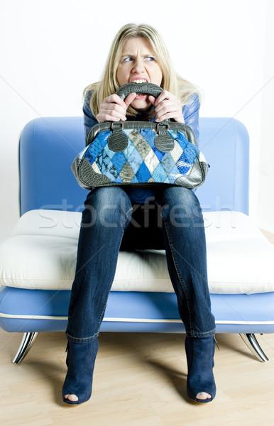 Kobieta niebieski ubrania torebka posiedzenia Zdjęcia stock © phbcz