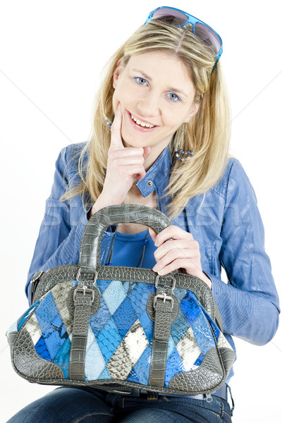portrait of sitting woman with handbag Stock photo © phbcz