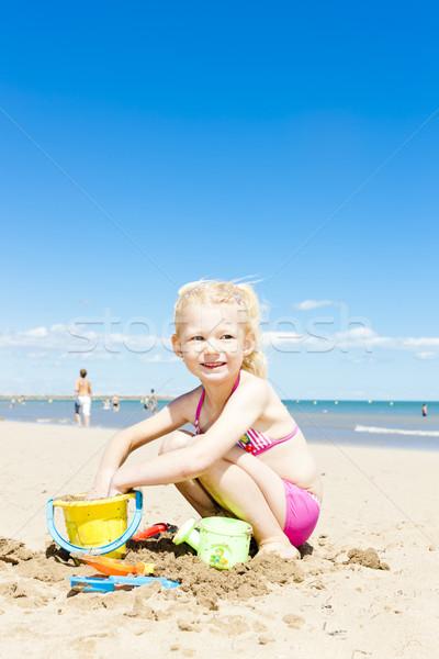 Stockfoto: Meisje · spelen · strand · zee · meisje · kind