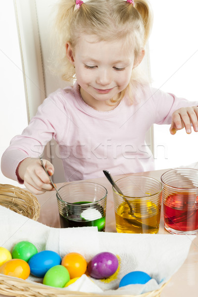 portrait of little girl during Easter eggs' coloration Stock photo © phbcz
