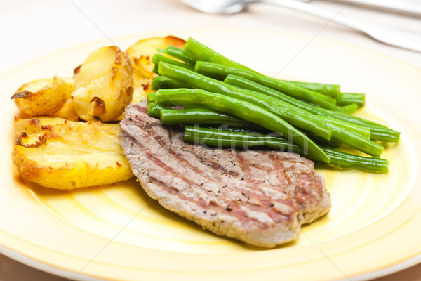 beefsteak with green beans and garlic potatoes Stock photo © phbcz