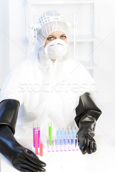 young woman wearing protective clothes in laboratory Stock photo © phbcz