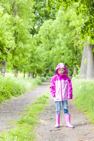 little girl wearing rubber boots in spring alley Stock photo © phbcz