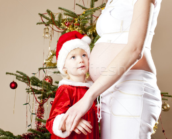portrait of little girl and her pregnant mother by Christmas tre Stock photo © phbcz