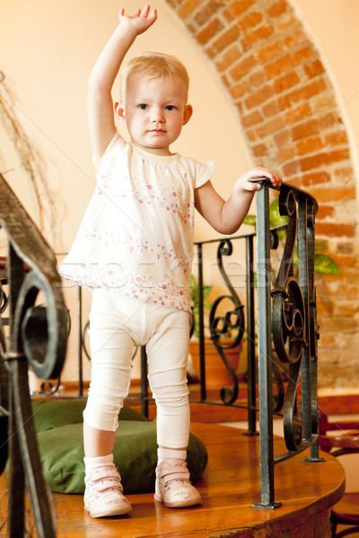 standing little girl Stock photo © phbcz