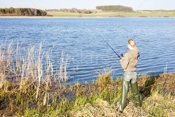 Kadın balık tutma gölet tek başına kadın bot Stok fotoğraf © phbcz