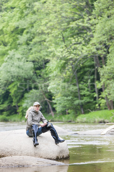 woman fishing in Sazava river, Czech Republic Stock photo © phbcz