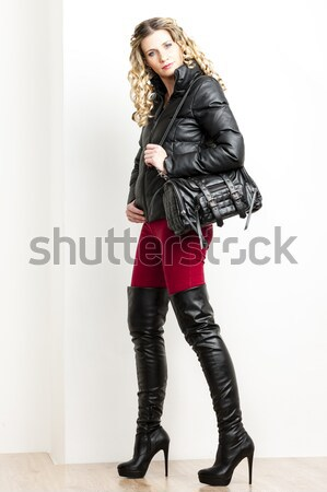 standing woman wearing extravagant clothes holding a whip and ha Stock photo © phbcz