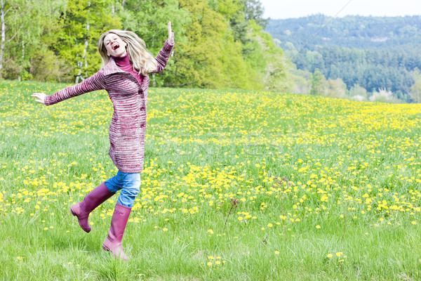 woman wearing rubber boots on spring meadow Stock photo © phbcz