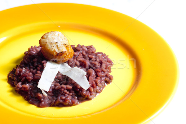 fried Saint Jacques mollusc on risotto steamed with red wine Stock photo © phbcz