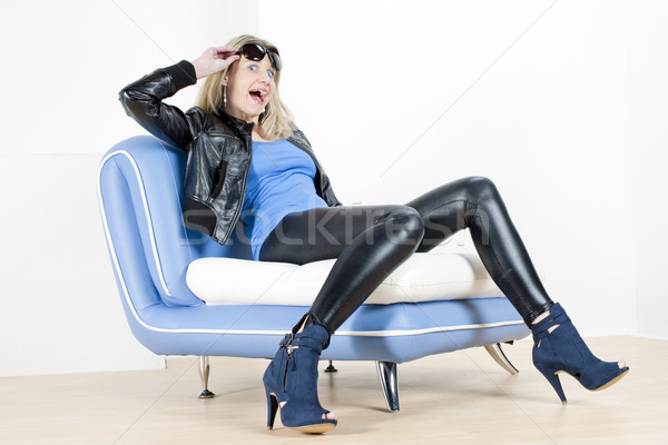 woman wearing fashionable shoes sitting on sofa Stock photo © phbcz