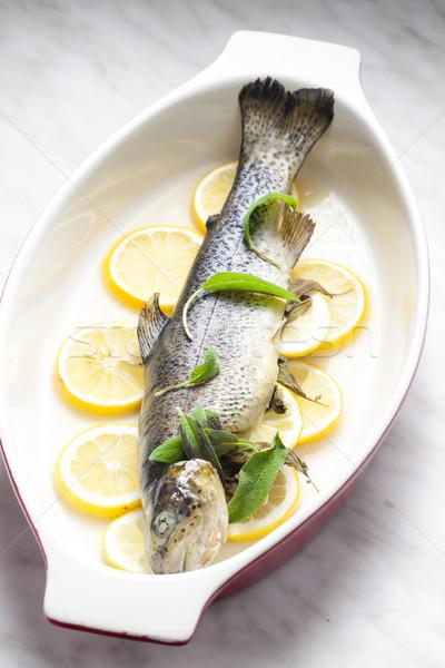 trout baked on lemon Stock photo © phbcz