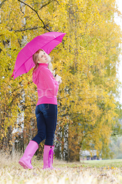 Stock photo: woman wearing rubber boots with umbrella in autumnal nature