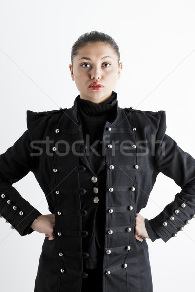 portrait of young woman wearing extravagant coat Stock photo © phbcz