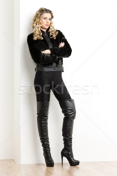 standing woman wearing fashionable black clothes and boots Stock photo © phbcz