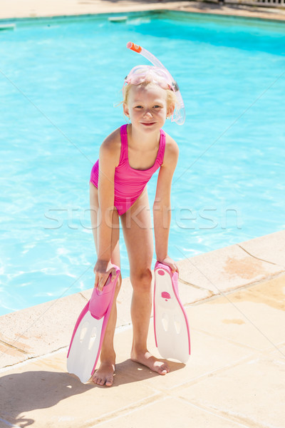 little girl with snorkeling equipment at swimming pool Stock photo © phbcz