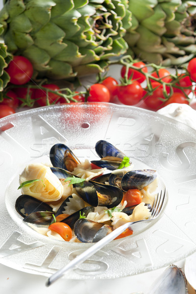 Stock photo: pasta with mussels, artichokes and cherry tomatoes