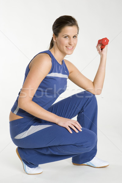 woman exercising with dumb bell Stock photo © phbcz