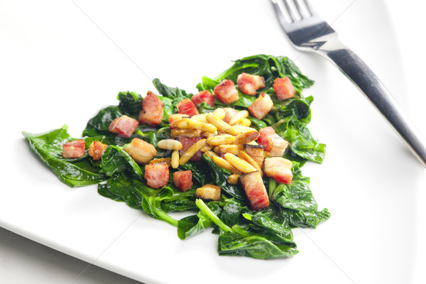 fried spinach with bacon and pine nuts Stock photo © phbcz
