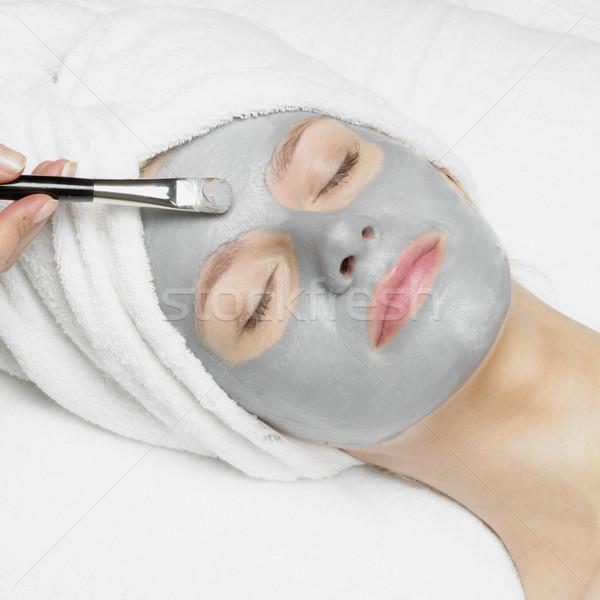Mulher máscara mão cara beleza jovem Foto stock © phbcz