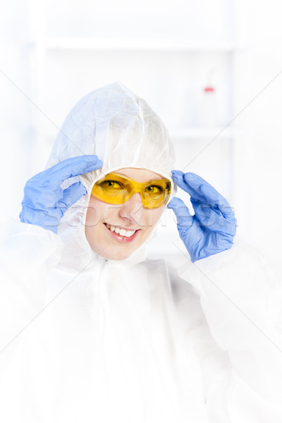 young woman with protective glasses and coat in laboratory Stock photo © phbcz
