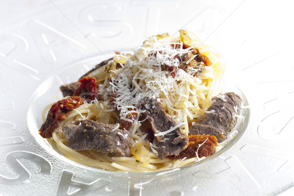 spaghetti with beef meat and dried tomatoes Stock photo © phbcz