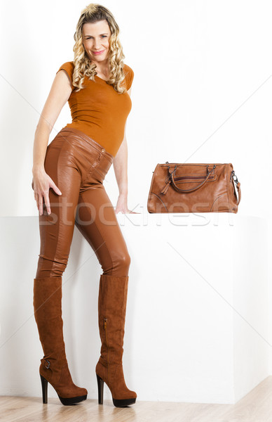 standing woman wearing brown clothes and boots with a handbag Stock photo © phbcz