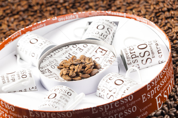 coffee cups stored in a box on coffee beans Stock photo © phbcz