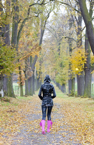 woman in autumnal alley Stock photo © phbcz