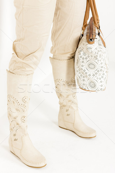 detail of standing woman wearing summer boots holding a handbag Stock photo © phbcz