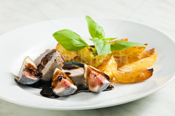 Stock photo: pork tenderloin with figs and sauce of balsamico vinegar