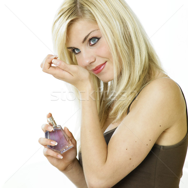 Stock photo: woman''s portrait with perfume