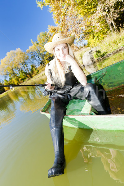 Pesca mujer sesión barco mujeres relajante Foto stock © phbcz