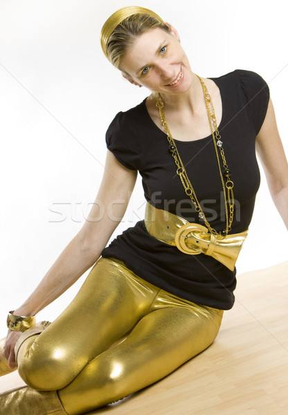 Stock photo: woman sitting on the floor