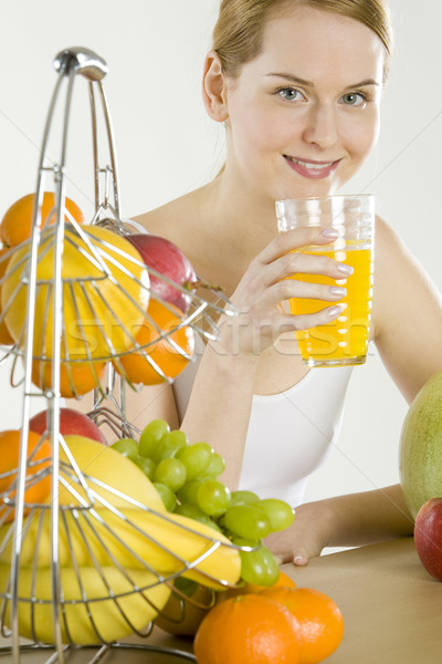 Mulher café da manhã fruto saúde laranja óculos Foto stock © phbcz