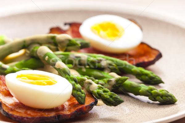 boiled green asparagus with bacon, egg and mustard dip Stock photo © phbcz