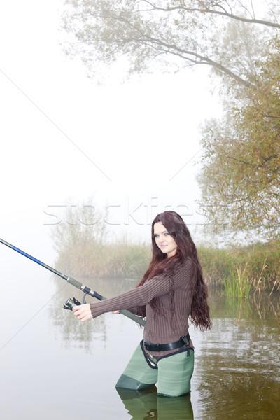 Donna pesca stagno donne autunno giovani Foto d'archivio © phbcz