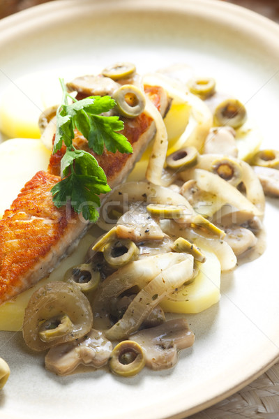 baked salmon on champignons, onion and olives Stock photo © phbcz
