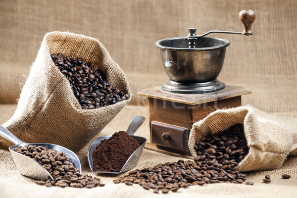 still life of coffee beans in jute bags with coffee grinder Stock photo © phbcz