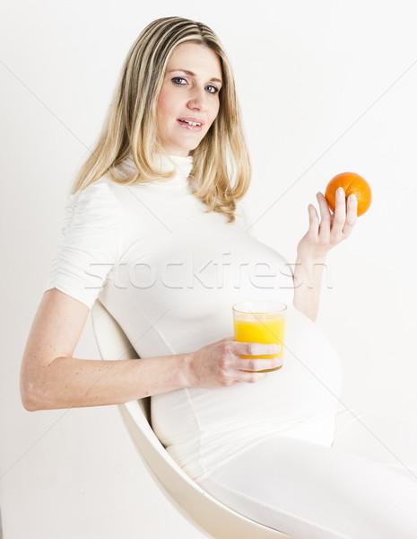 Stockfoto: Portret · zwangere · vrouw · glas · sinaasappelsap · oranje · voedsel